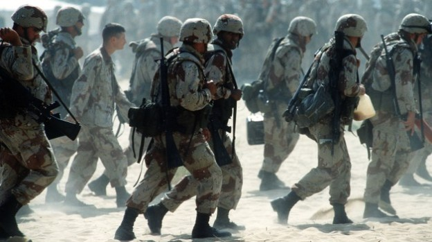 Newly arrived Marines are led through an encampment near an airfield during Operation Desert Shield. Department of Defense Photo