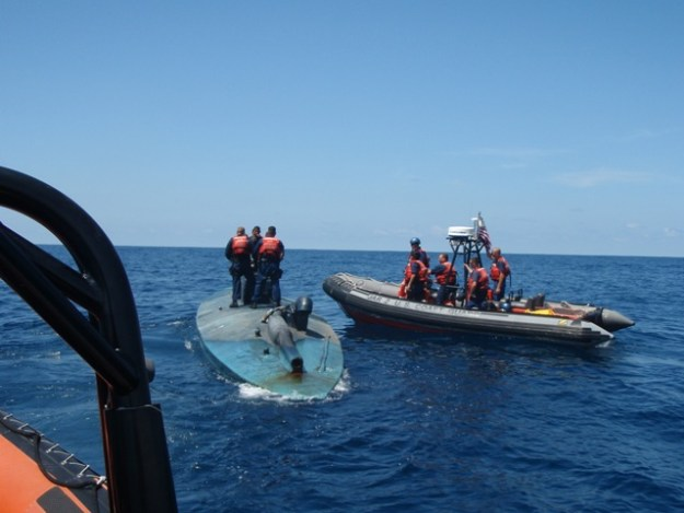 Crew from CGC Jarvis detain a self-propelled semi-submersible (SPSS) in the Eastern Pacific off the coast of Central America, on Oct. 21, 2009. US Coast Guard Photo