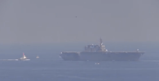 An image from a Sept. 23 video showing JS Izumo leaving Tokyo Bay on Sept. 23. YouTube
