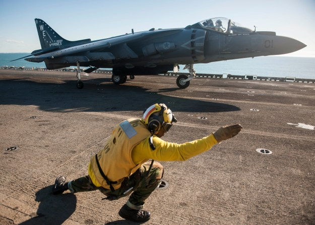 An AV-8B Harrier from the Black Sheep of Marine Attack Squadron (VMA) 214 on the flight deck of the amphibious assault ship USS Bonhomme Richard (LHD-6) on Aug. 4, 2013. US Navy Photo