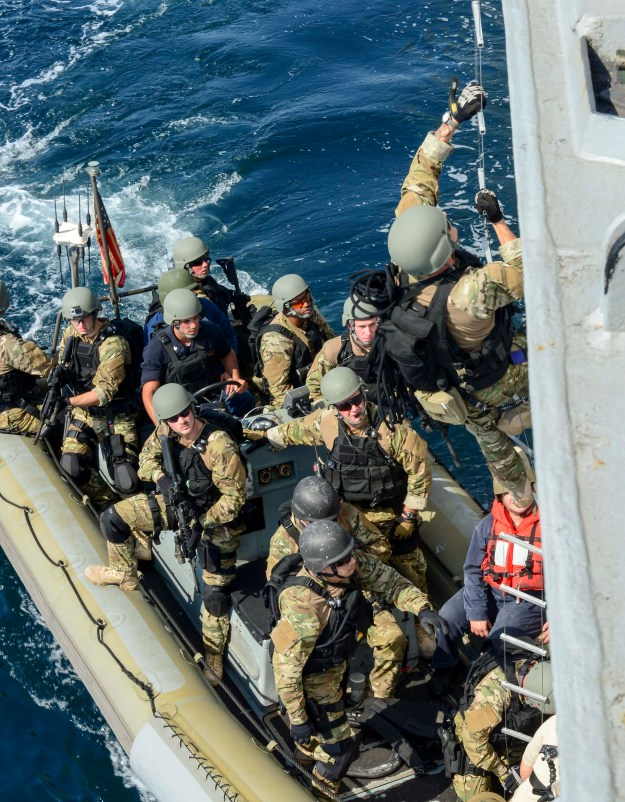 Visit, board, search and seizure team members pull alongside the Arleigh Burke-class guided-missile destroyer USS Sterett (DDG-104) to practice ship boarding. US Navy Photo