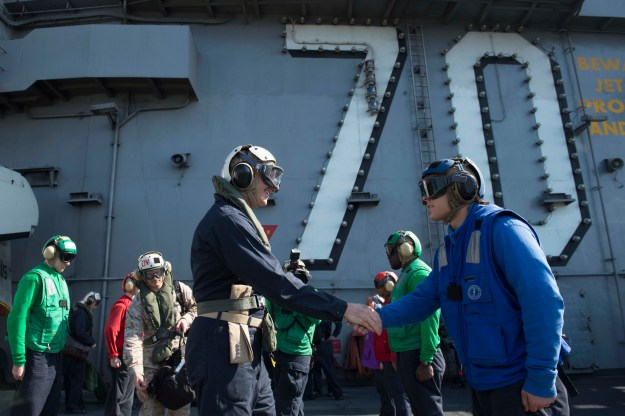 Chief of Naval Operations (CNO) Adm. Jonathan Greenert is welcomed aboard the aircraft carrier USS Carl Vinson (CVN 70) on Nov. 27, 2014. US Navy Photo