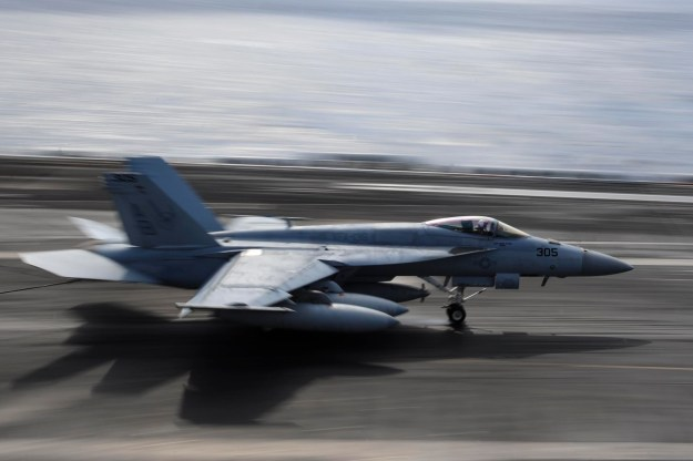 F/A-18E Super Hornet assigned to the Knighthawks of Strike Fighter Attack Squadron (VFA) 136 lands on the flight deck of the Nimitz-class aircraft carrier USS Theodore Roosevelt (CVN 71) on Jan. 30, 2015. US Navy Photo