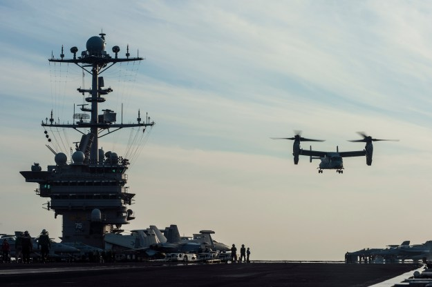 An MV-22 Osprey, assigned to Marine Medium Tiltrotor Squadron 166, launches from the flight deck of the aircraft carrier USS Harry S. Truman (CVN-75). US Navy Photo