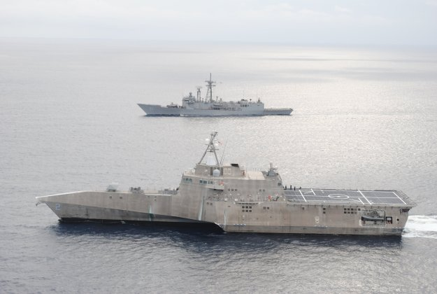 The guided-missile frigate USS Gary (FFG-51), top, and the littoral combat ship USS Independence (LCS-2) conduct a photo exercise off the coast of Central America in January. US Navy photo.