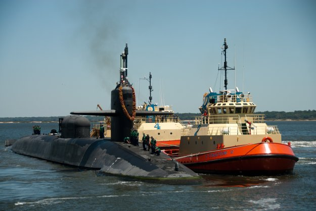 The Ohio-class guided-missile submarine USS Florida (SSGN 728) arrives at Naval Submarine Base Kings Bay in April 2011. Florida returned after a 15-month deployment that included participated in Operation Odyssey Dawn, making the boat the first guided-missile submarine to launch Tomahawk land attack missiles. US Navy photo.