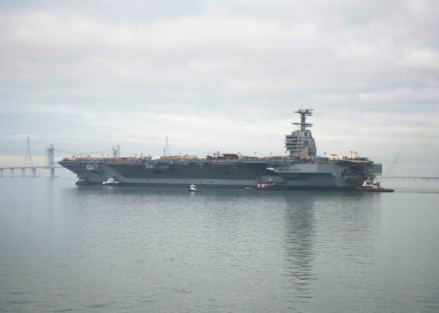 Pre-Commissioning Unit Gerald R. Ford (CVN 78) transits the James River during the ship's launch and transit to Newport News Shipyard pier three for the final stages of construction and testing in November 2013. US Navy photo.