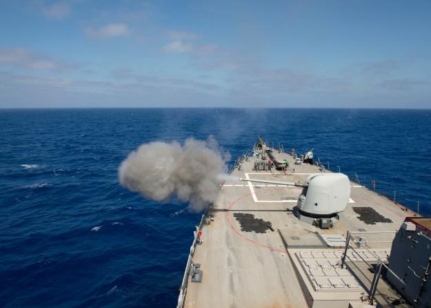USS Ross (DDG-71) test fires the MK45 5-inch lightweight gun on April 30, 2015. US Navy Photo