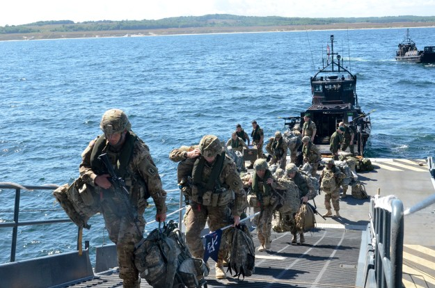 US Army paratroopers from the 173rd Airborne Brigade embark aboard the Royal Navy amphibious helicopter carrier HMS Ocean during exercise Baltic Operations (BALTOPS) 2015 on June 9, 2015. US Navy Photo