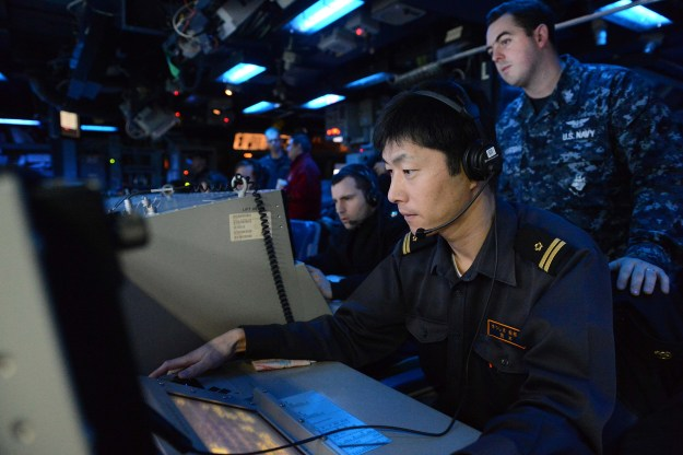 A member of the Japan Maritime Self Defense Force works inside the combat operations center of the Ticonderoga-class guided-missile cruiser USS Antietam (CG 54) on Nov. 27, 2013. US Navy Photo