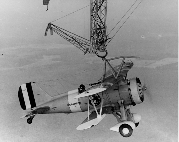 Curtiss F9C-2 Sparrowhawk hangs from USS Macon (ZRS-5).