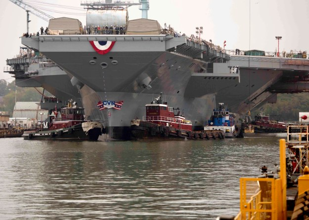 he aircraft carrier Gerald R. Ford (CVN 78) gets underway, beginning the ship's launch and transit to Newport News Shipyard pier 3 for the final stages of construction and testing in November 2013. US Navy photo.