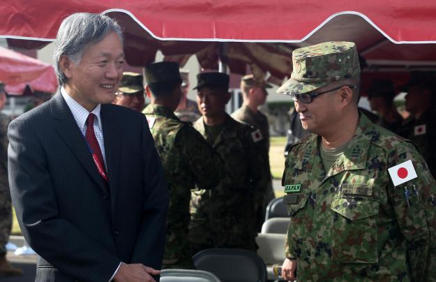 Harry H. Horinouchi (left), the Consul-General of Japan, Los Angeles, speaks with Japan Ground Self Defense Force Col. Yoshiyuki Goto, Western Army Infantry Regimental Commander on Jan. 22, 2016. US Marine Corps