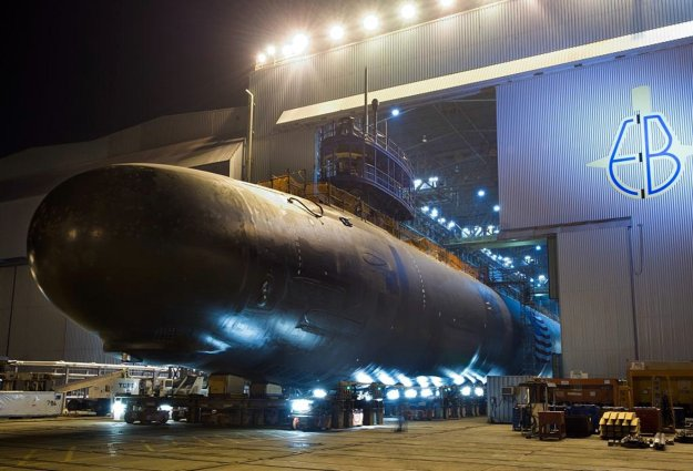 The Virginia-class attack submarine North Dakota (SSN-784) is rolled out of an indoor shipyard facility at General Dynamics Electric Boat in Groton, Conn., in Sept. 2013. US Navy photo.