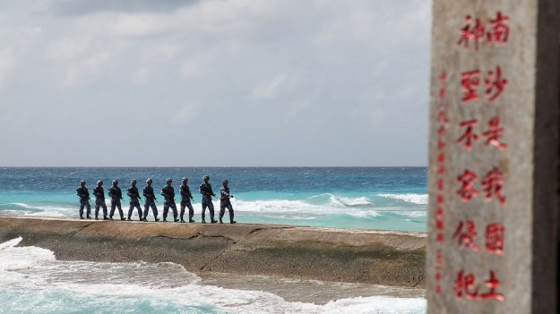 Chinese troops patrol disputed holding in the Spratly Islands. Photo via Reuters