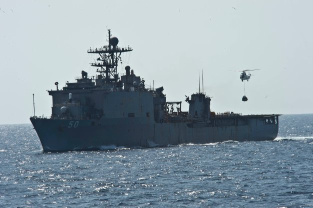 USS Carter Hall (LSD-50) during a replenishment-at-sea with the Military Sealift Command dry cargo and ammunition ship in 2013. US Navy Photo