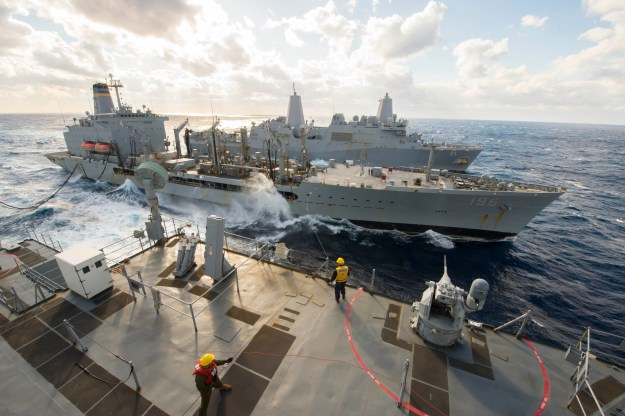 The Whidbey Island-class amphibious dock landing ship USS Fort McHenry (LSD 43), front, and the San Antonio-class amphibious transport dock USS New York (LPD 21), conduct an underway replenishment with the Military Sealift Command fleet replenishment oiler USNS Kanawha (T-AO-196) while operating in the Mediterranean Sea in January 2015. US Navy photo.