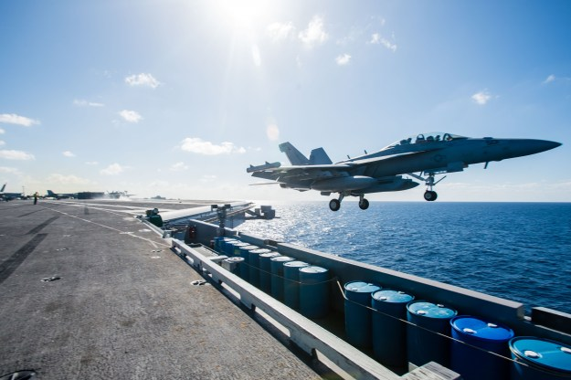 An E/A-18G Growler assigned to the Wizards of Electronic Attack Squadron (VAQ) 133 takes off from USS John C. Stennis' (CVN 74) flight deck on November 15, 2015. US Navy photo.