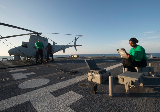 Sailors aboard the littoral combat ship USS Fort Worth (LCS 3) prepare to launch an MQ-8B Fire Scout unmanned aircraft system on Aug. 15, 2015. US Navy photo.
