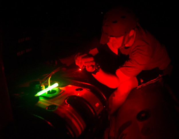 Mineman 3rd Class Brandon Workman, attached to Commander, Task Group 56.1, inspects the Seabotix robot after recovering it from a night dive during the International Mine Countermeasure Exercise (IMCMEX) 16 on April 13, 2016. US Navy Photo