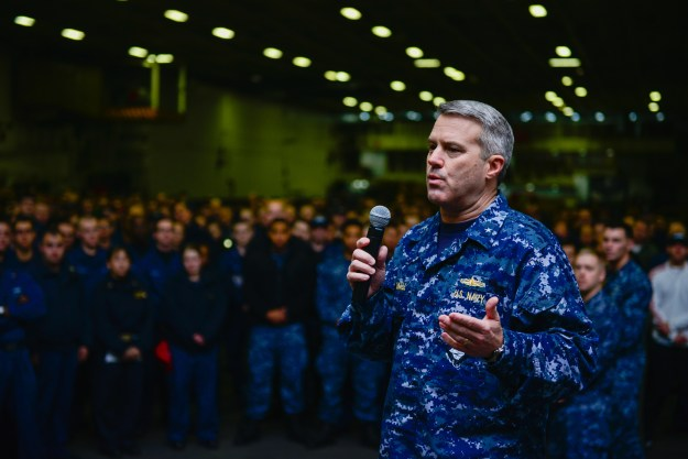 Rear Adm. Ronald Boxall, commander of the John C. Stennis Strike Group, speaks during an all hands call in the hangar bay of Nimitz-class aircraft carrier USS John C. Stennis (CVN 74) in December 2014. US Navy photo.