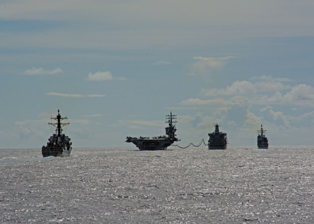 Ships assigned to the Eisenhower Carrier Strike Group (Ike CSG) conduct a replenishment-at-sea with the Military Sealift Command fleet replenishment oiler USNS Big Horn (T-AO 198) on June 2, 2016. US Navy photo.