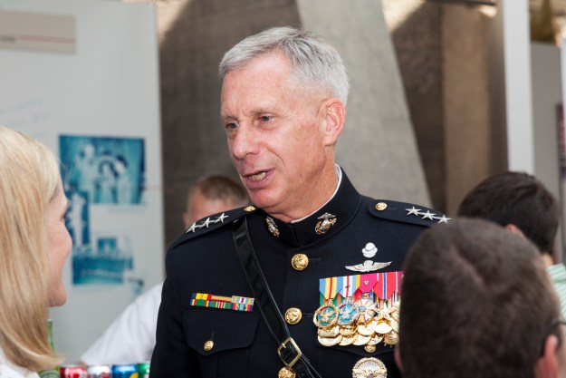 U.S. Marine Corps Lt. Gen. Thomas Waldhauser, director for joint force development, Joint Staff J7, speaks with a guest during the sunset parade reception at the Women in Women in Military Service for America Memorial, Arlington, Va., June 23, 2015. US Marine Corps photo.