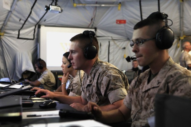 Marine tactical air command squadron 48 Marines receive aircraft and ground troop information on their monitors during Operation Javelin Thrust at Marine Corps Air Station Yuma, Ariz., July 24, 2011. US Marine Corps photo.