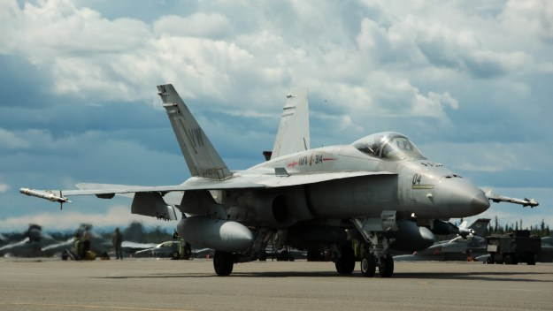 A U.S. Marine Corps F/A-18C Hornet aircraft with Marine Fighter Attack Squadron (VMFA) 314, stationed at Marine Corps Air Station Miramar, California, taxis down the runway at Eielson Air Force Base, Alaska on June 20, 2016. US Marine Corps Photo
