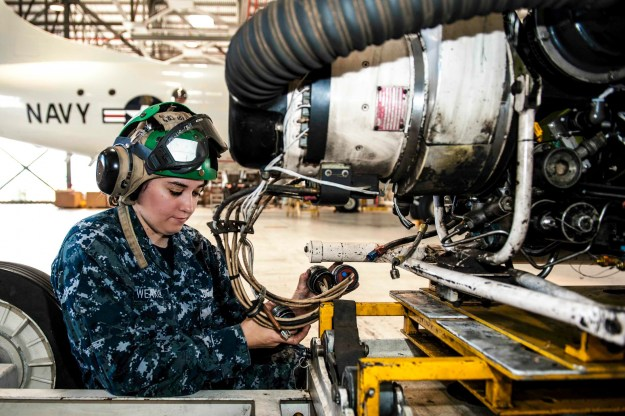 Aviation Machinist's Mate Airman Danielle Weakley, assigned to the Golden Eagles of Patrol Squadron (VP) 9, inspects engine three from a P-3C Orion maritime patrol aircraft as part of the squadron's advanced readiness program on June 10, 2015. US Navy photo.