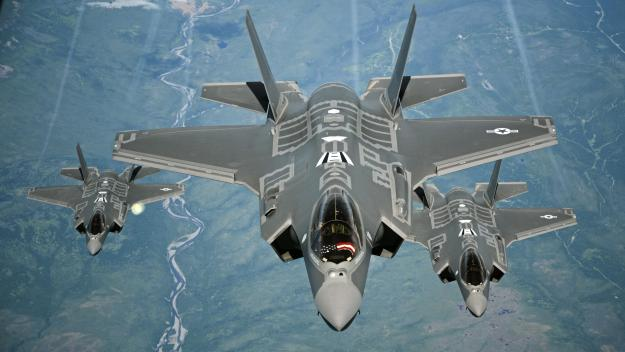 F-35A Lightning II aircraft receive fuel from a KC-10 Extender on July 13, 2016, during a flight from England to the U.S. after participating in the world's largest air show, the Royal International Air Tattoo. US Air Force photo.