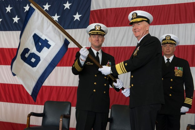 Vice Adm. James Foggo III, right, commander of U.S. 6th Fleet, hands Capt. Jeffrey Wolstenholme the Commander, Task Force 64 (CTF 64) guidon during the command's establishment ceremony at U.S. Naval Support Activity Naples March 24, 2016. US Navy photo.