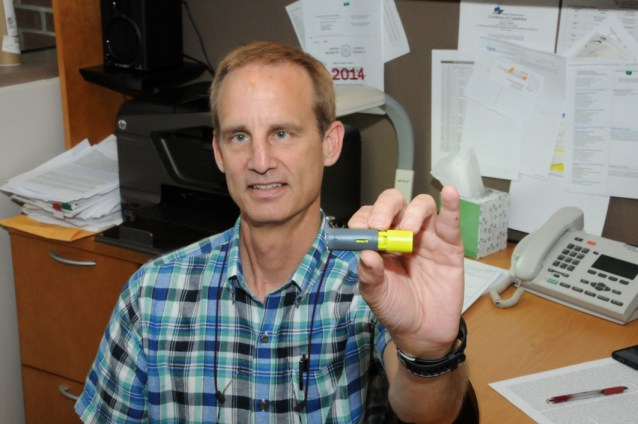 Dr. S. Casey Laizure holds an Aeroshot™ 100 mg caffeine administration device, an integral part of his NIH-funded study, sold by Breathable Foods, Inc. The study of this device, which dispenses caffeine upon inspiration, will provide insight into caffeine blood levels achieved after inhalation.