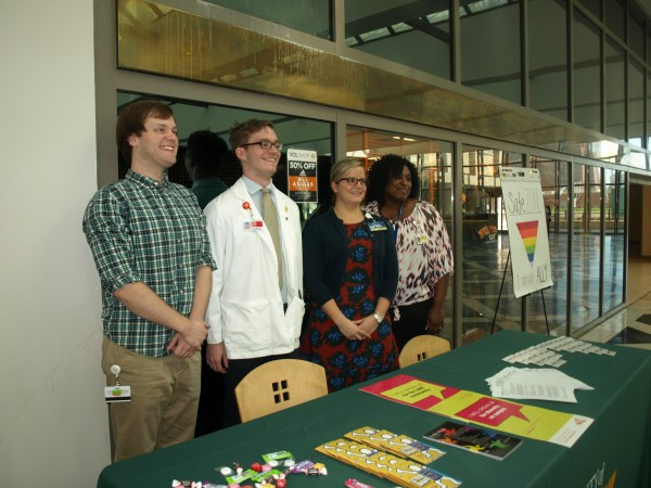 From left, Ben Edwards, M1; Peter Duden, M1; Maggie Joyce, Office of Equity and Diversity; and Nikki Dyer, Student Academic Support Services, offered information at the recent Unite event.