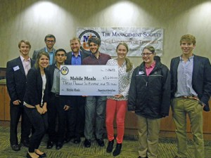UT Management Society students with the check for Mobile Meals