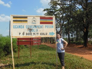 Daniels outside of the prison in Uganda.