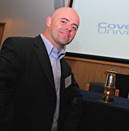 Pate with the Paralympic flame in a photo taken at a disability sport conference at Coventry University in Coventry, England, just before the 2012 Paralympic Games in London.