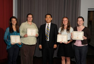 Sungkyu Lee, middle, poses with four social work students who won the 2012 EUReCA competition, a UT undergraduate research and creative achievement exhibition.