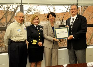 From left, Jim Foggin, ESGR Representative for the Navy Operational Support Center in Knoxville, Capt. Teresa Kennard, College of Nursing Dean Victoria P. Niederhauser, and Army Reserve Ambassador John Dyess.