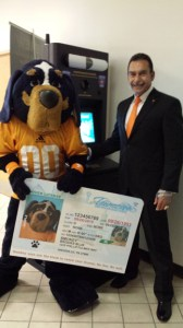 Smokey poses with his new temporary license and Larry Godwin, deputy commissioner for the Tennessee Department of Safety and Homeland Security.