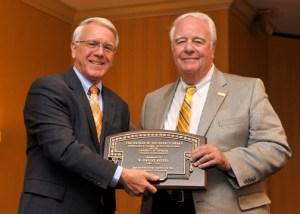College of Engineering Dean Wayne Davis, left, presenting the 2014 Nathan W. Dougherty Award to Dwight Kessel.