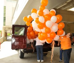 Shannon Bruce, right, and Bonnie Frank load up the balloons.