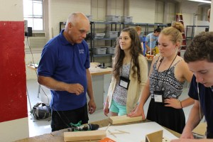 UT engineering professor Will Schleter, from left, works with Science Hill's Julie Wyse and St. George's Independent's Julia Spinolo during the Governor's School for the Sciences and Engineering at Estabrook Hall on Friday, June 20, 2014.