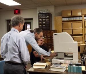 Dan Feller, left, and Tom Coens, center, speak with Henry Rollins for the History Channel.