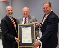 President Emeritus Joe Johnson poses after receiving a lifetime