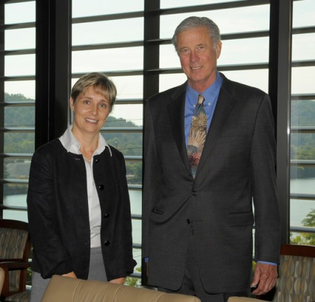 Jim Gibson, right, stands next to College of Engineering Professor and Associate Dean for Faculty Affairs Veerle Keppens during the opening of the Jim Gibson Conference Room in 2013.