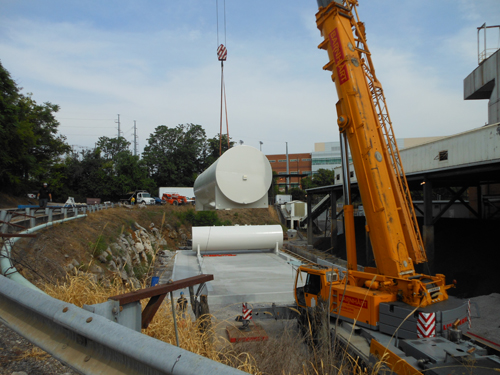 A crane transports equipment as part of the upgrade of the university's steam plant.