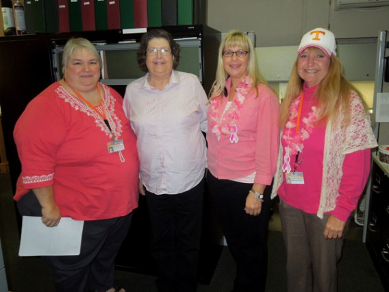 "Facilities Services Administrative Support team members Amy Miller, Arlene Williams, Mitzi Prowell and Ann Free show their support for Breast Cancer Awareness during ""Wear Pink Day."""