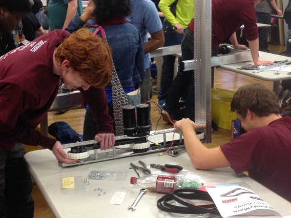 Bearden High School's Patrick Woodworth, left, and Shea Payne look over their team's robot.