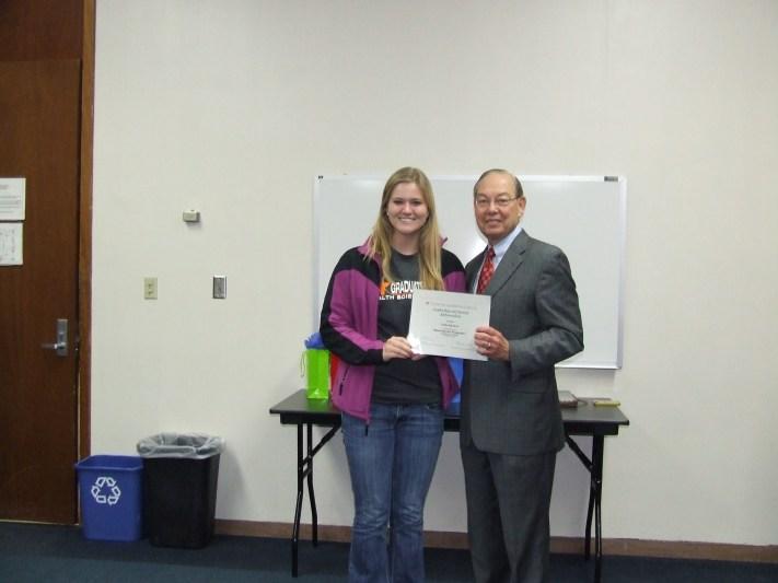 Chancellor Cheek Presents Award to Leadership and Service Ambassador Erika Sanders
